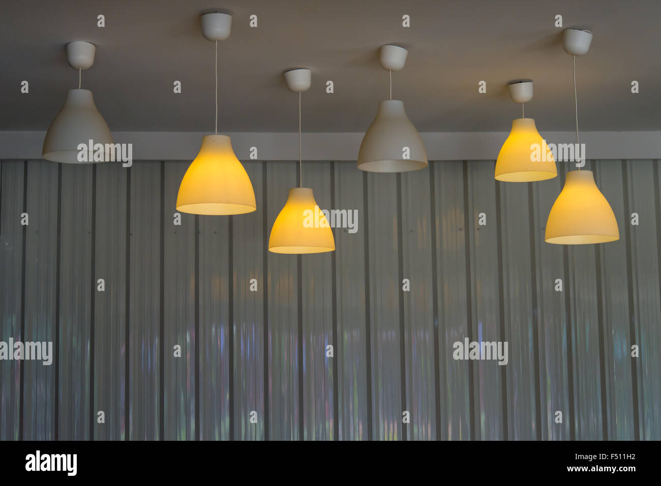 Recessed ceiling lights in a coffee shop - Stock Image