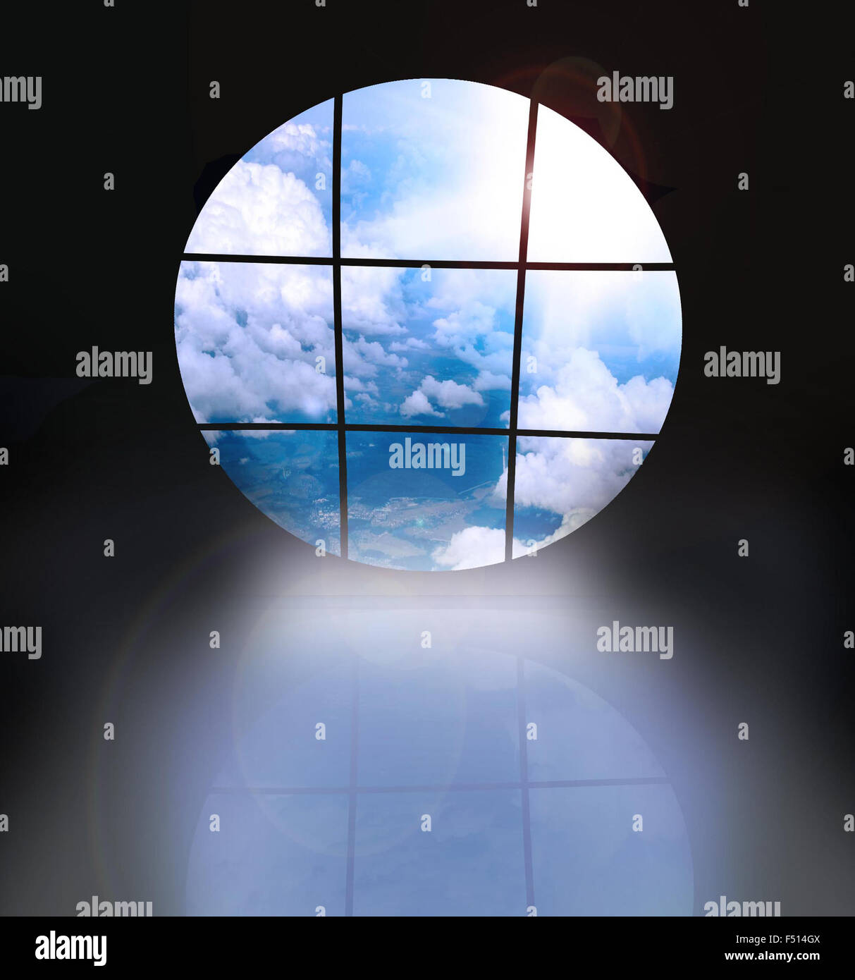dark room with screens showing a blue sky - Stock Image