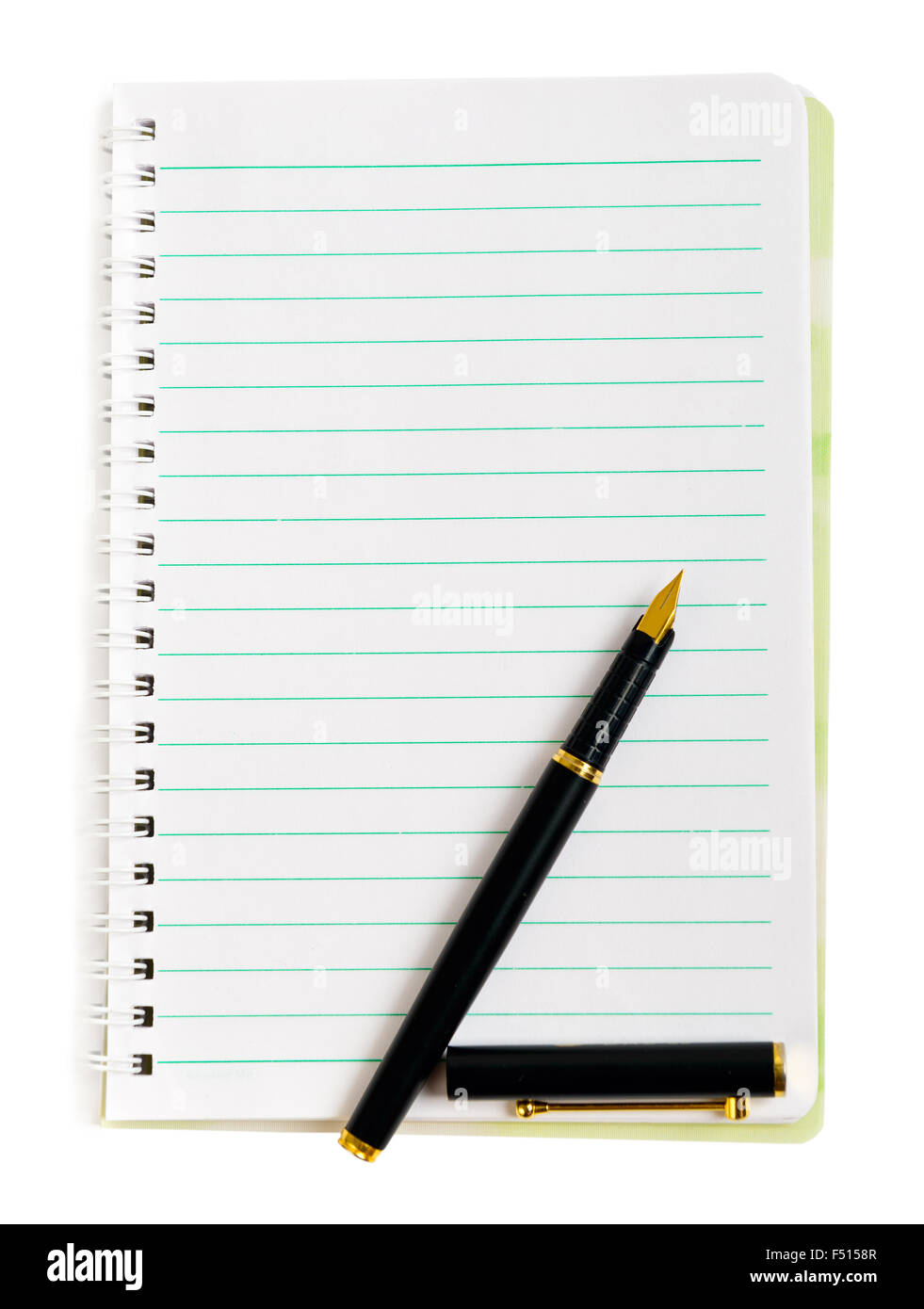Ink pen on lined notepad paper isolated on white - Stock Image
