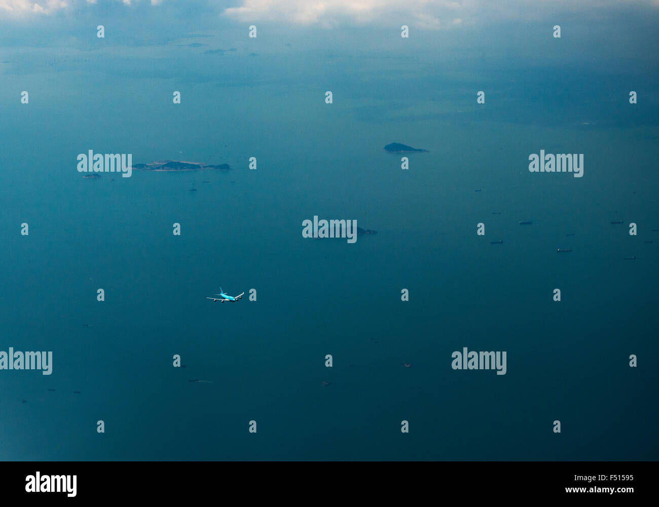 Korean Air flying over the South China Sea. - Stock Image