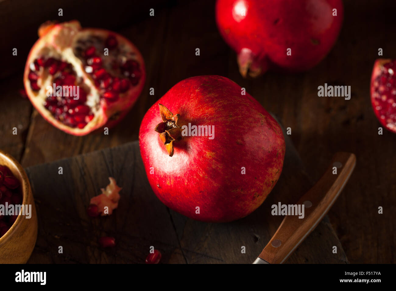Raw Organic Red Pomegranates Ready to Eat - Stock Image