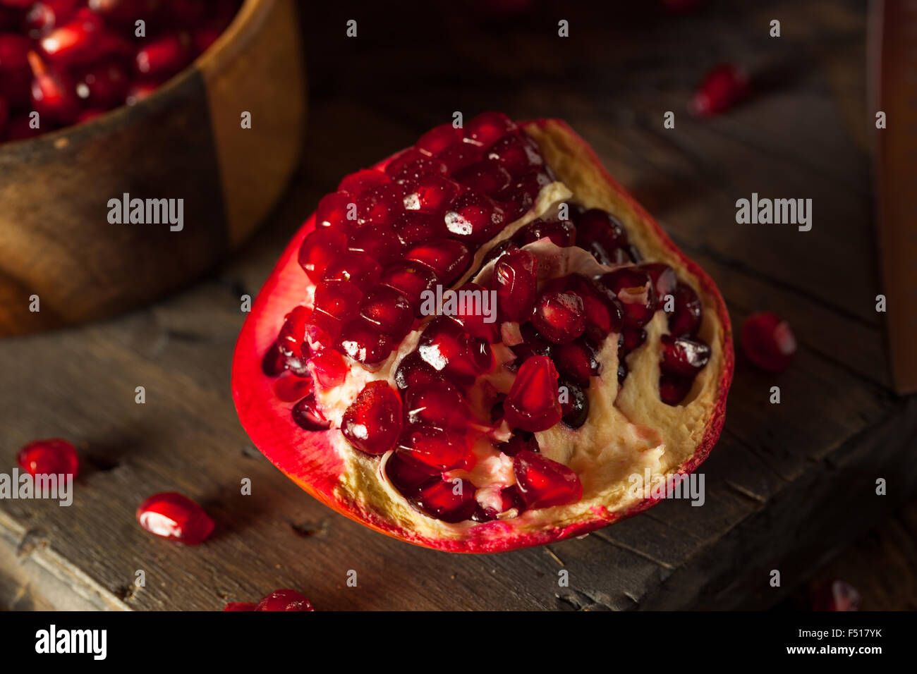 Raw Organic Red Pomegranates Ready to Eat - Stock Image