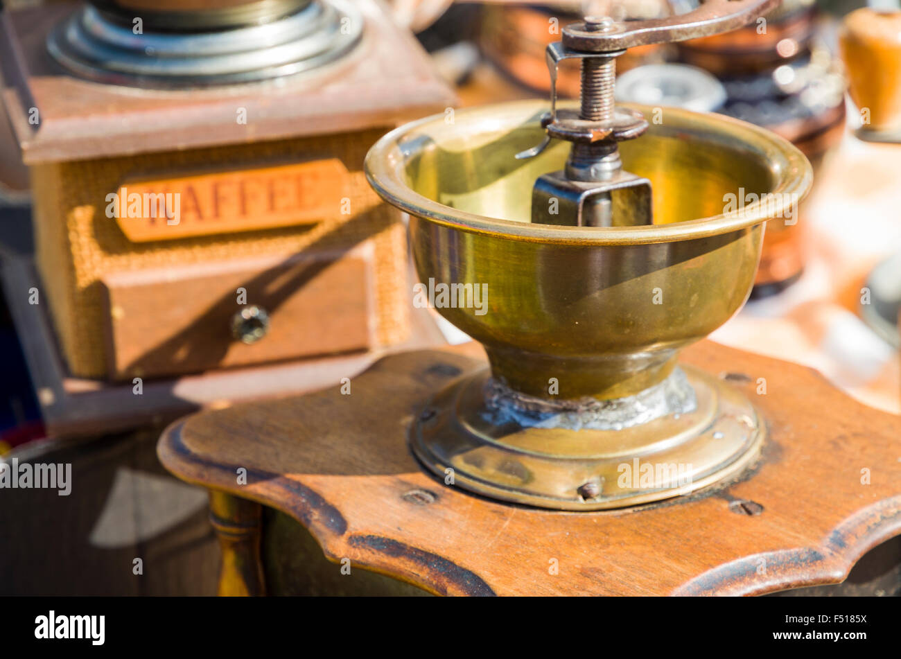 Old coffee mills are offered for sale at the weekly flea market aside the river Elbe - Stock Image