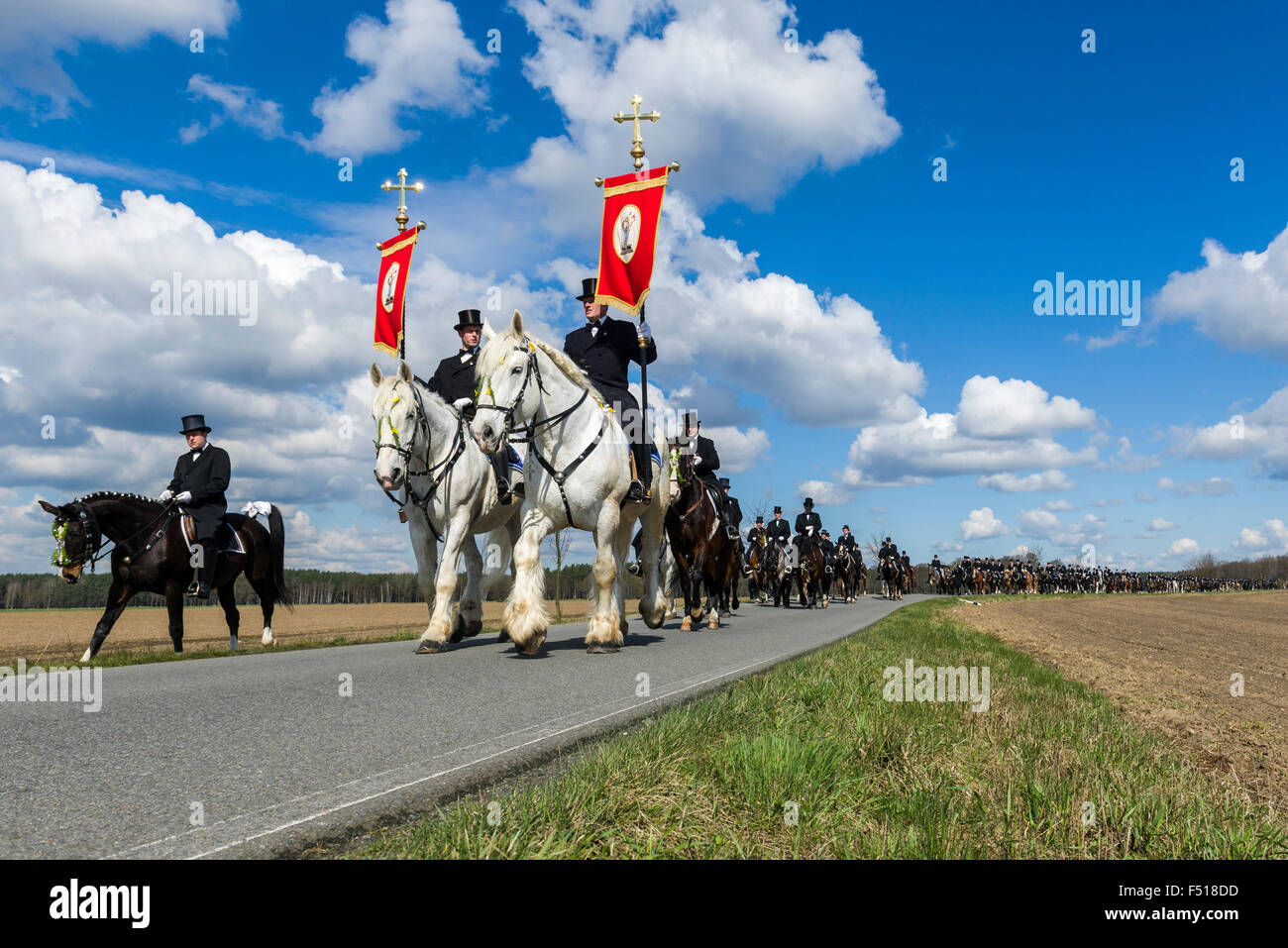 A procession on horses is tradition in sorbian culture at Easter Day, joined by hundreds of men - Stock Image