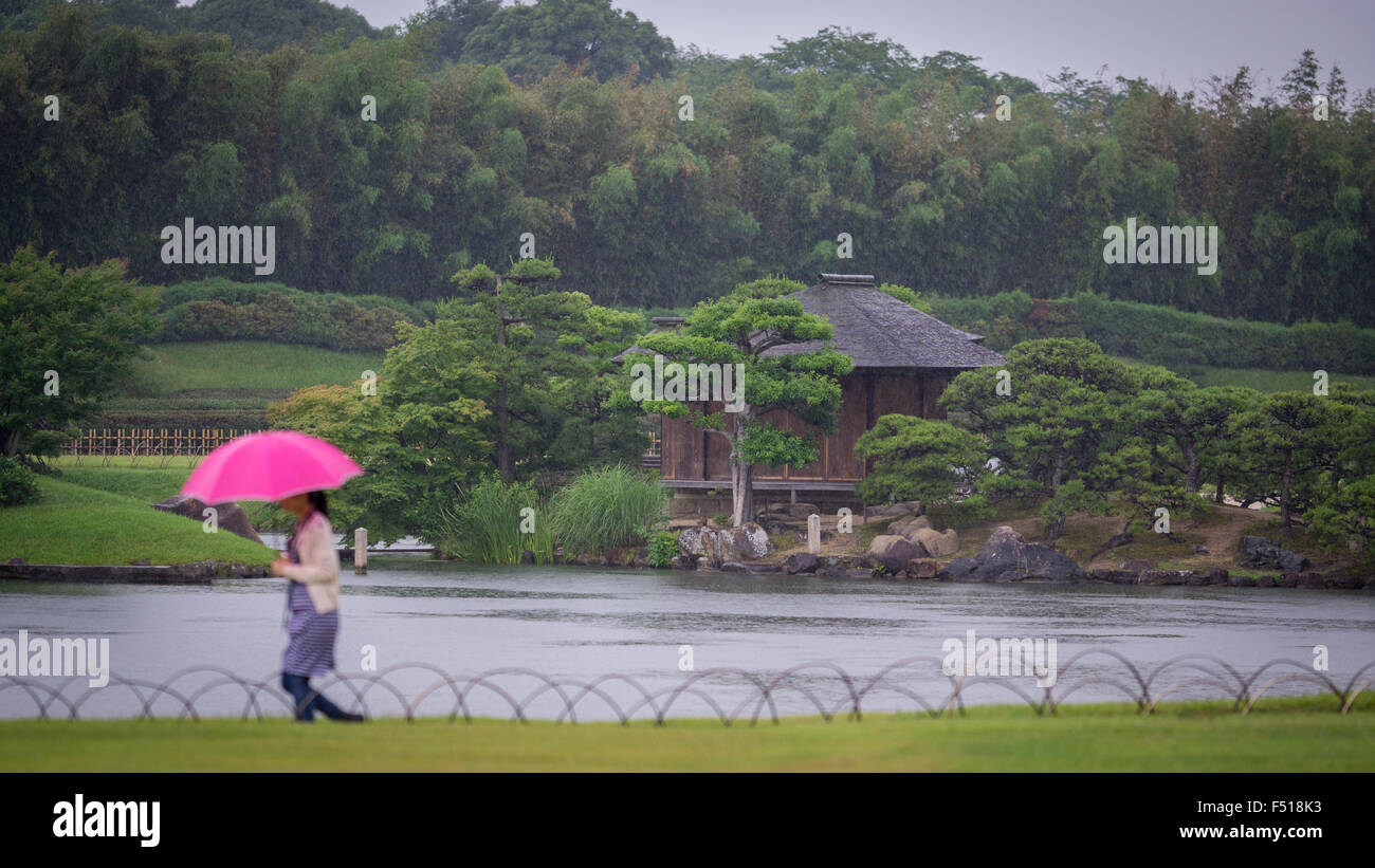 Raining in japanese park - Stock Image