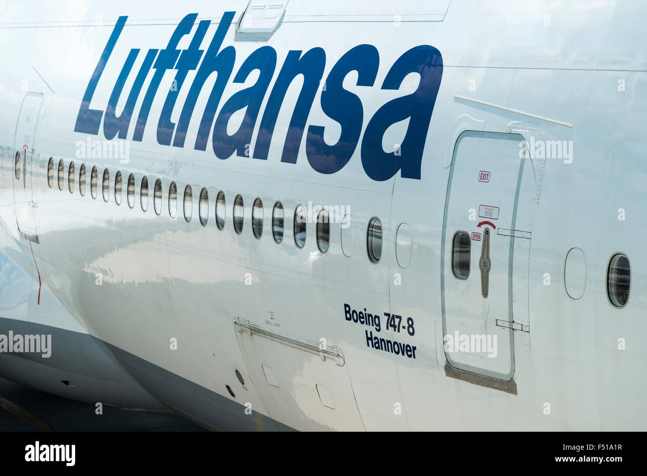 The door of the parking Boeing 747 Hannover of the airline Lufthansa at Frankfurt International Airport & The door of the parking Boeing 747 Hannover of the airline Lufthansa ...