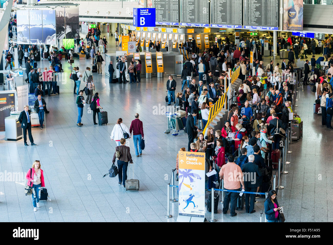 Many people are waiting for Check-in at Terminal 1 of Frankfurt International Airport - Stock Image