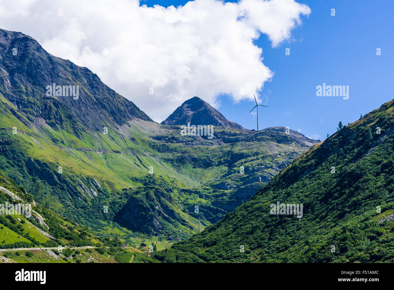 A wind powerplant is erected on mountains at high altitude near Nufenenpass - Stock Image