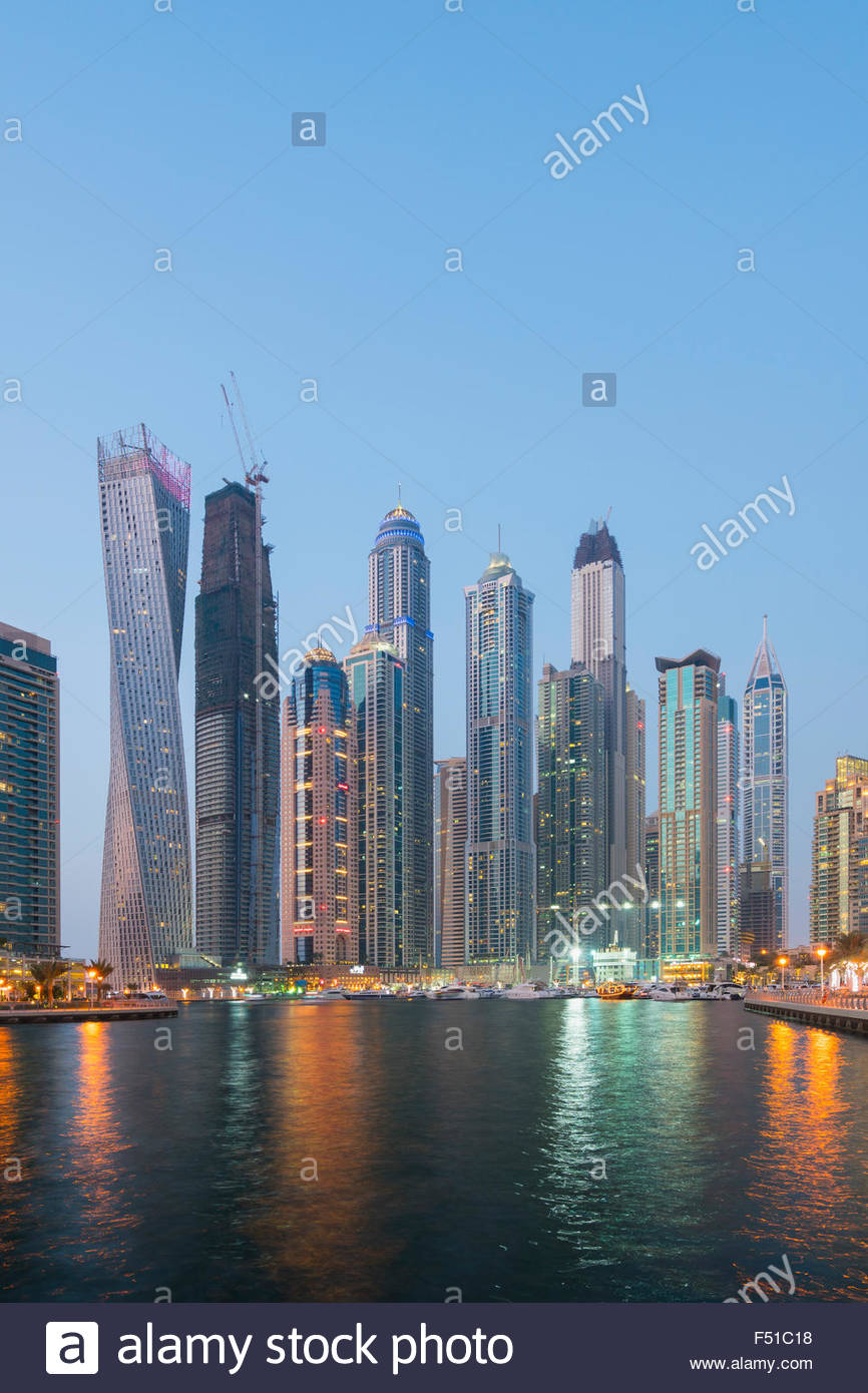 Skyline of skyscrapers  at night in  Marina district of Dubai United Arab Emirates - Stock Image