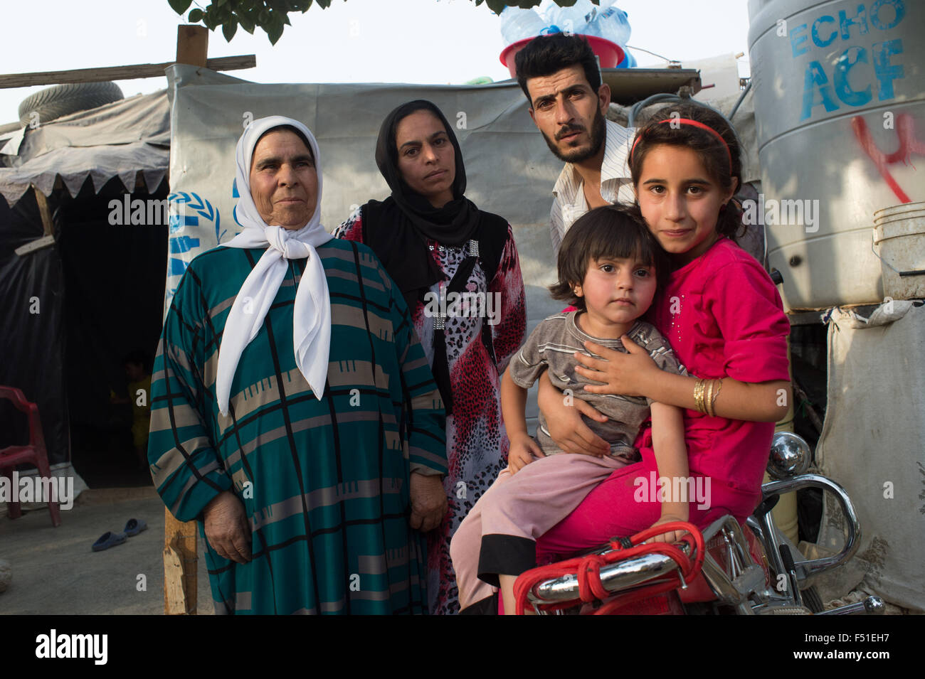 Family of syrian refugee in the Bekka valley near Zahle, in the UN camp. Zahle, Lebanon July 2015 - Stock Image