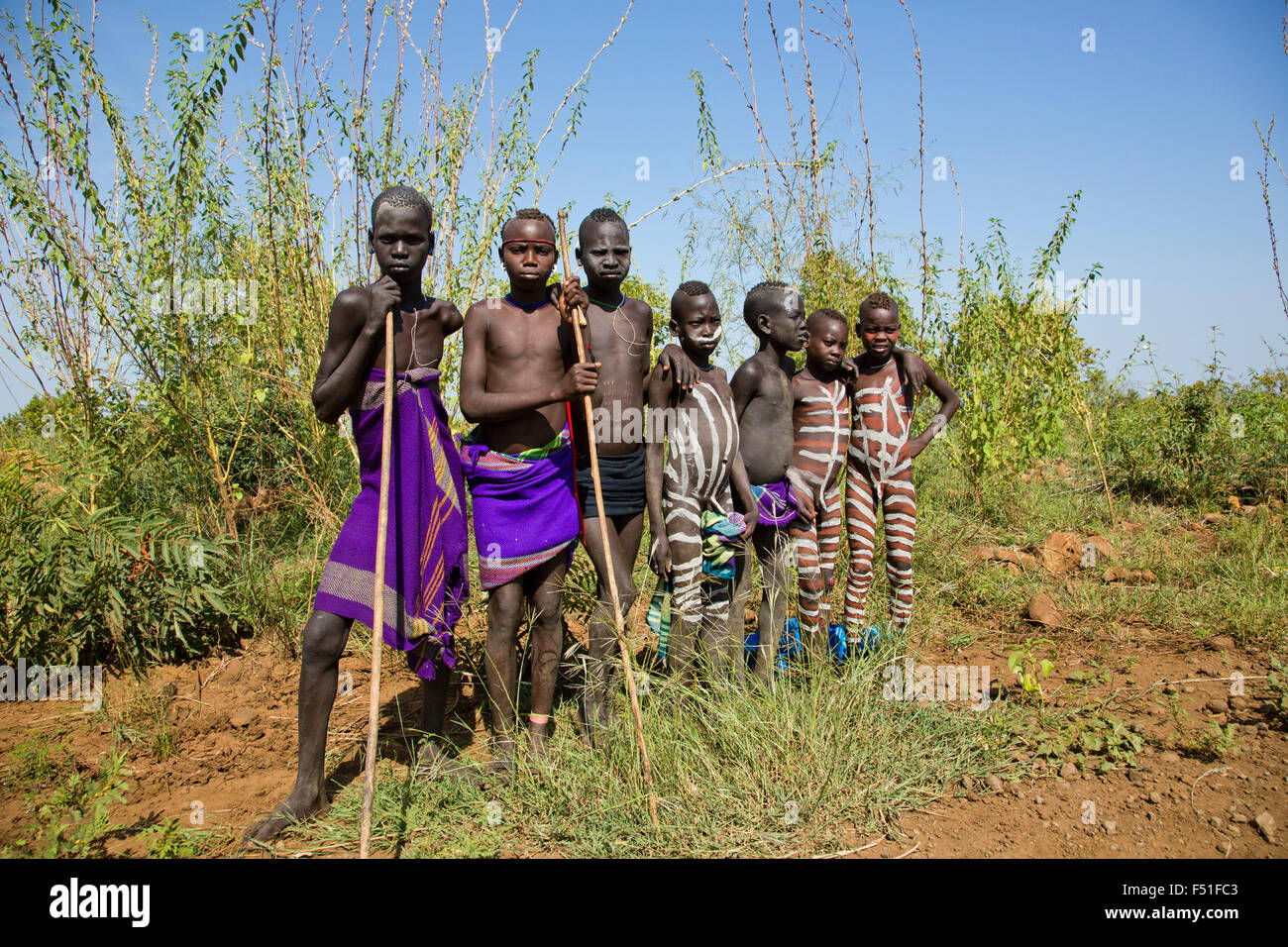 A group of young Mursi boys. Debub Omo Zone, Ethiopia, close to the Sudanese border. - Stock Image