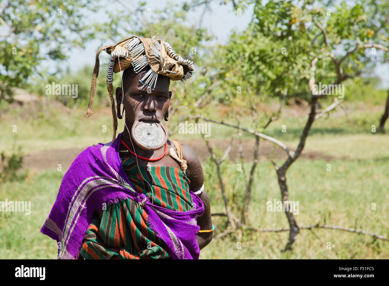 Woman of the Mursi tribe with clay lip disc as body ornamentstribe Debub Omo Zone, Ethiopia. Close to the Sudanese - Stock Image