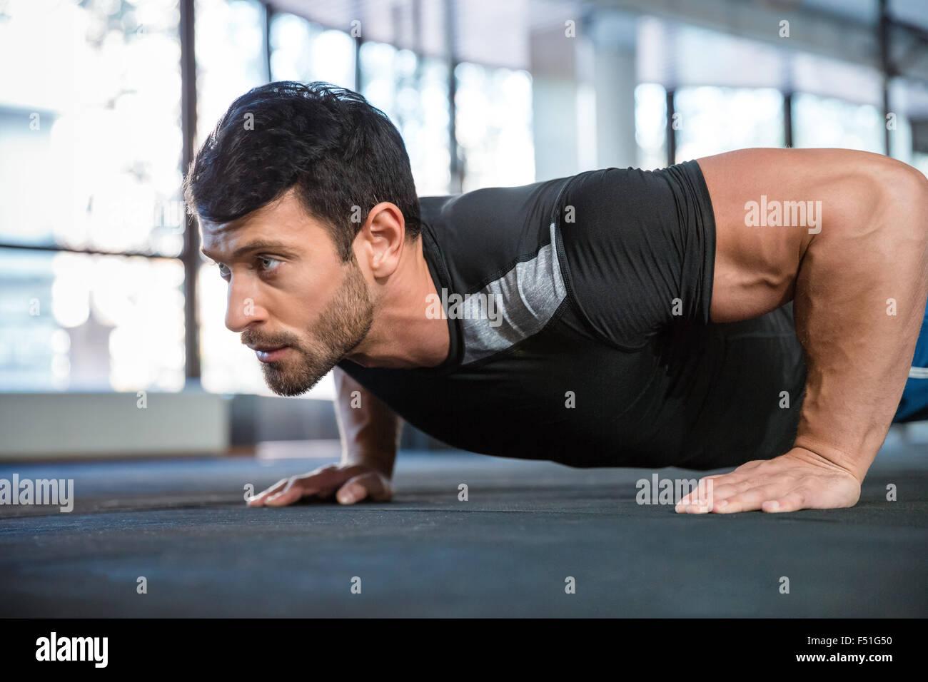 Athlet wearing black t-shirt training arms - Stock Image