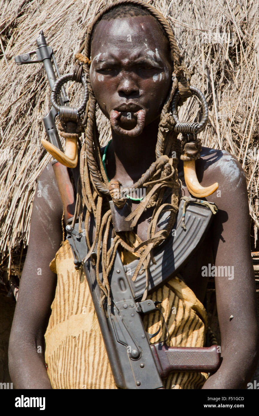 Woman of the Mursi with elongated lower lip to hold a clay disk as body ornamentstribe Debub Omo Zone, Ethiopia. - Stock Image