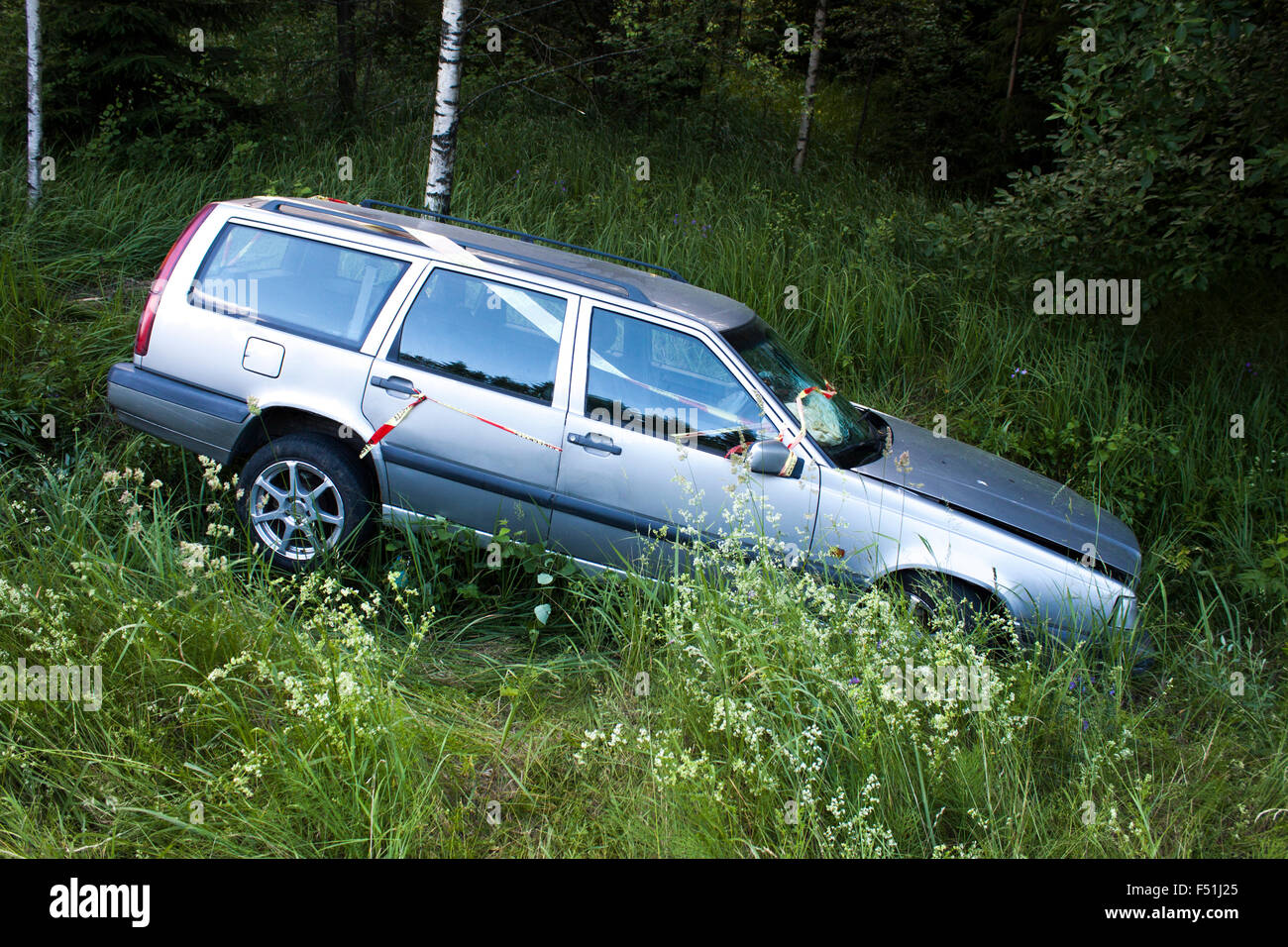 A crashed car on the side of the road Stock Photo: 89161245 - Alamy