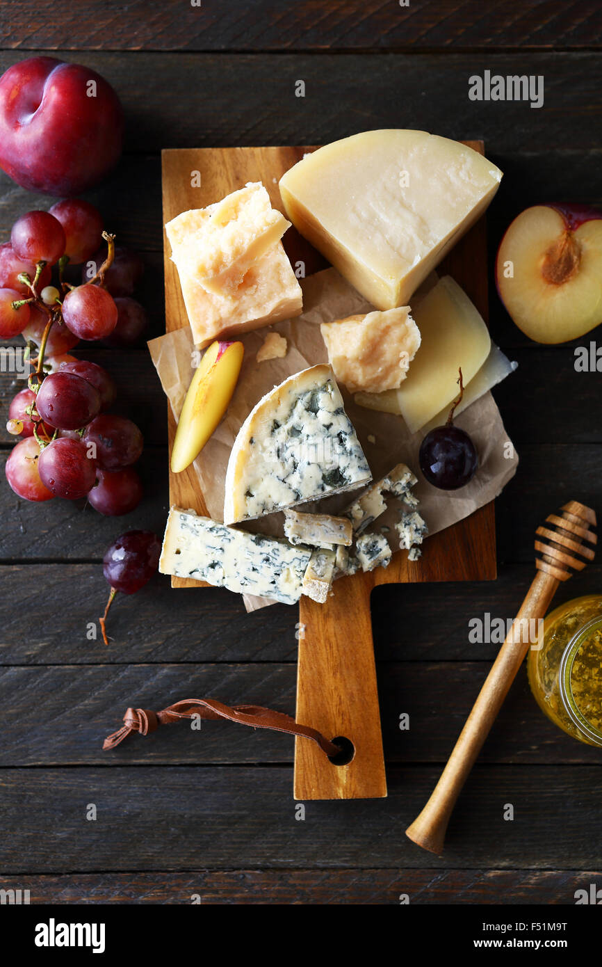 mix cheeses on rustic boards, food - Stock Image