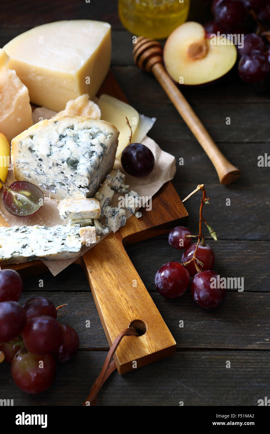 red grapes and blue cheese, food closeup - Stock Image