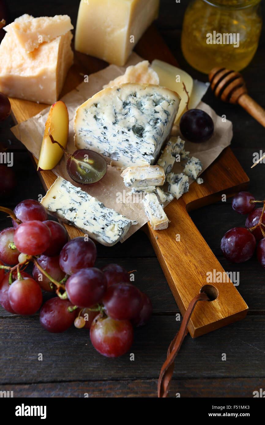 fresh grapes and blue cheese, food closeup - Stock Image