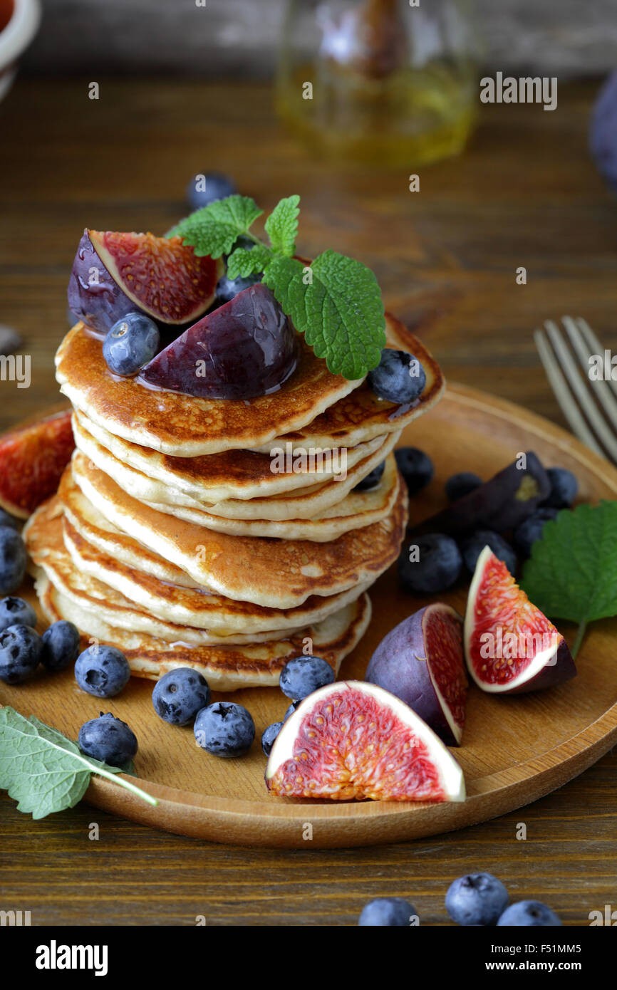 pancakes with figs and honey, food closeup - Stock Image