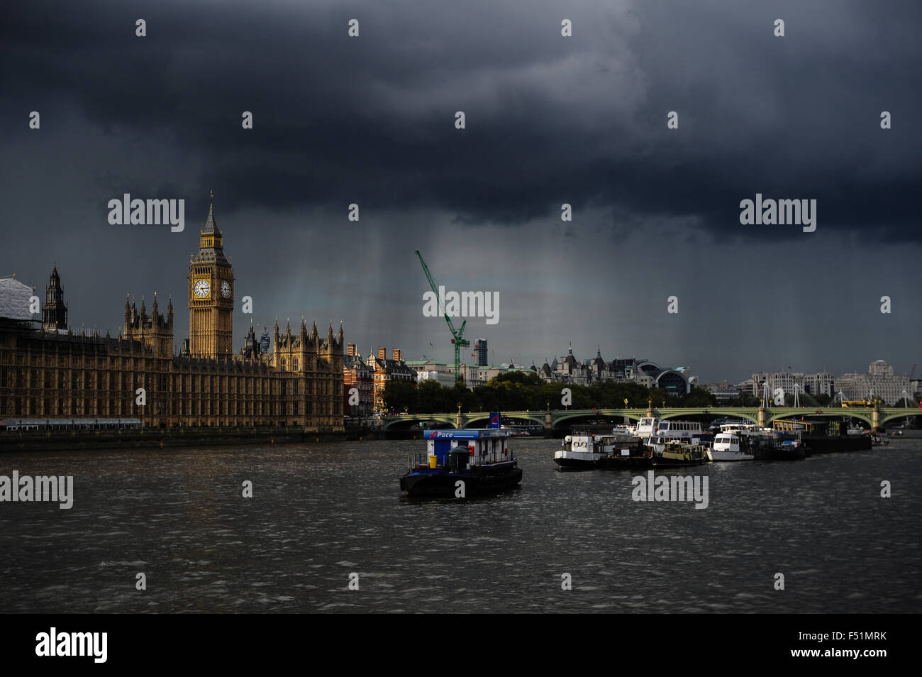 A view of House of Commons and the Thames as a dark cloud
