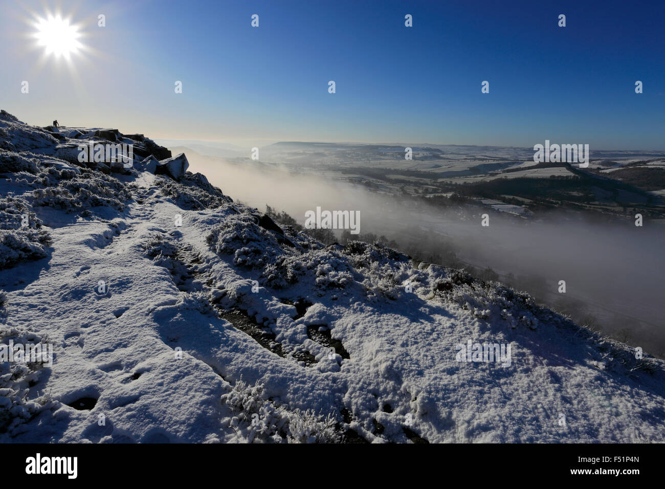 January, winter snow and mist over Curbar valley; Derbyshire County; Peak District National Park; England; UK - Stock Image