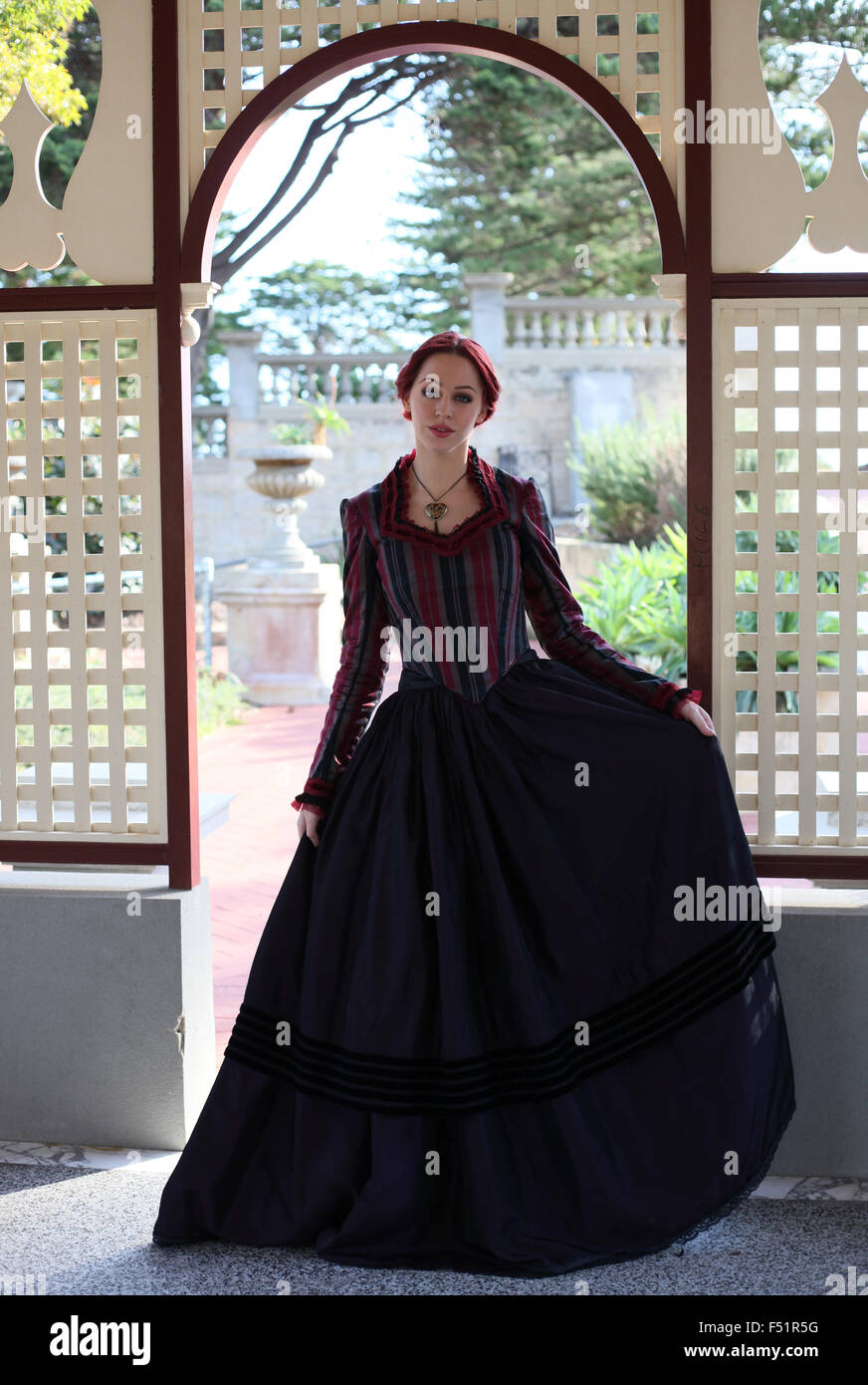 Portrait Of A Beautiful Red Haired Girl Wearing Gothic Inspired Victorian Era Clothes Vampire Or