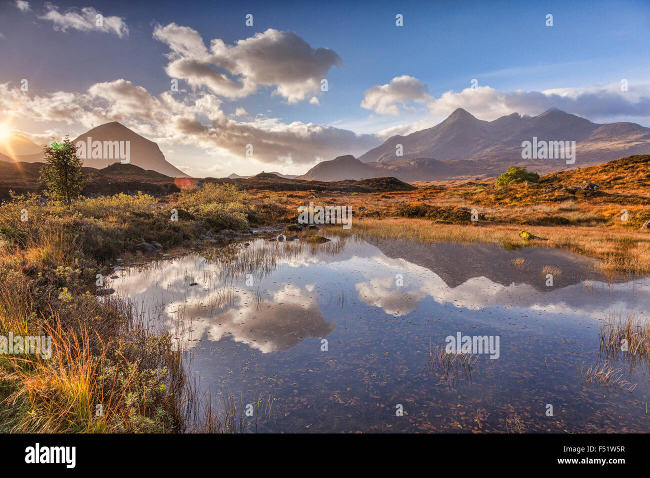 The Cuillins, autumn, at sunrise, reflected in a pool of water, Isle of Skye, Inner Hebrides, Highland, Scotland, Stock Photo
