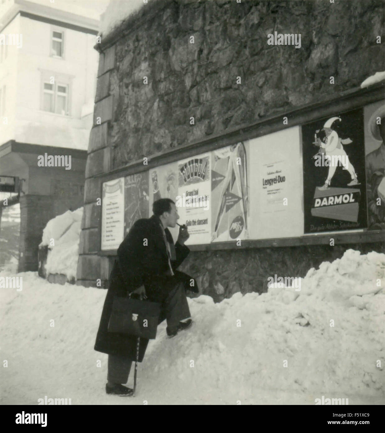 A man reads the posters attached , France - Stock Image