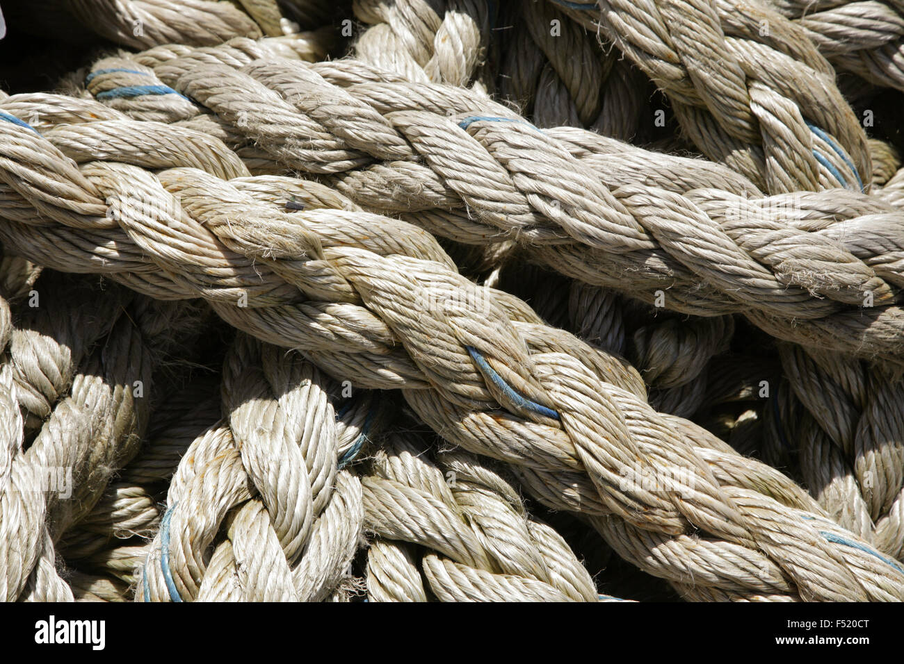 Lengths of grey rope. - Stock Image