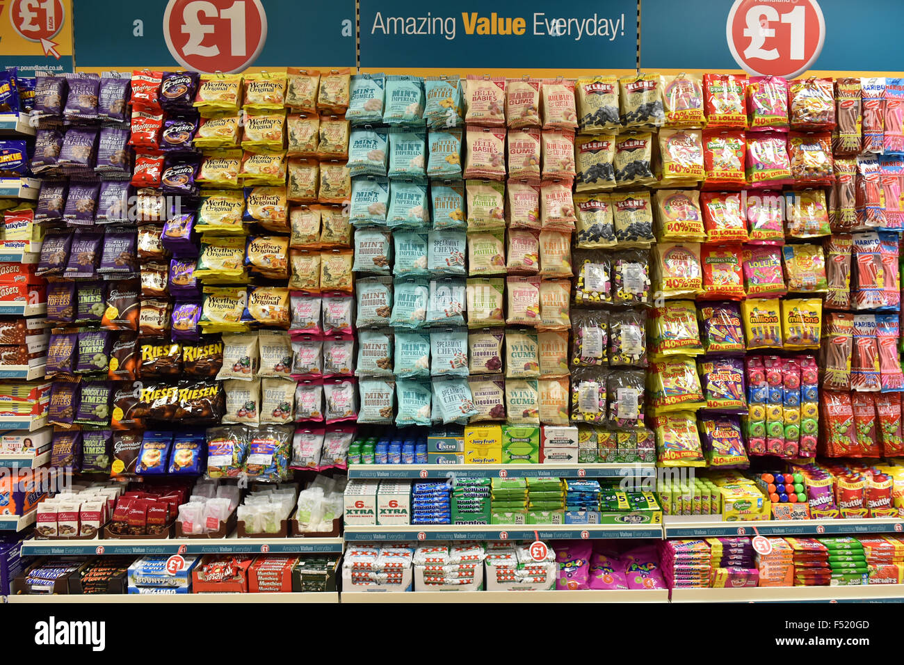 Display of cheap sugary sweets in a pound shop, UK - Stock Image