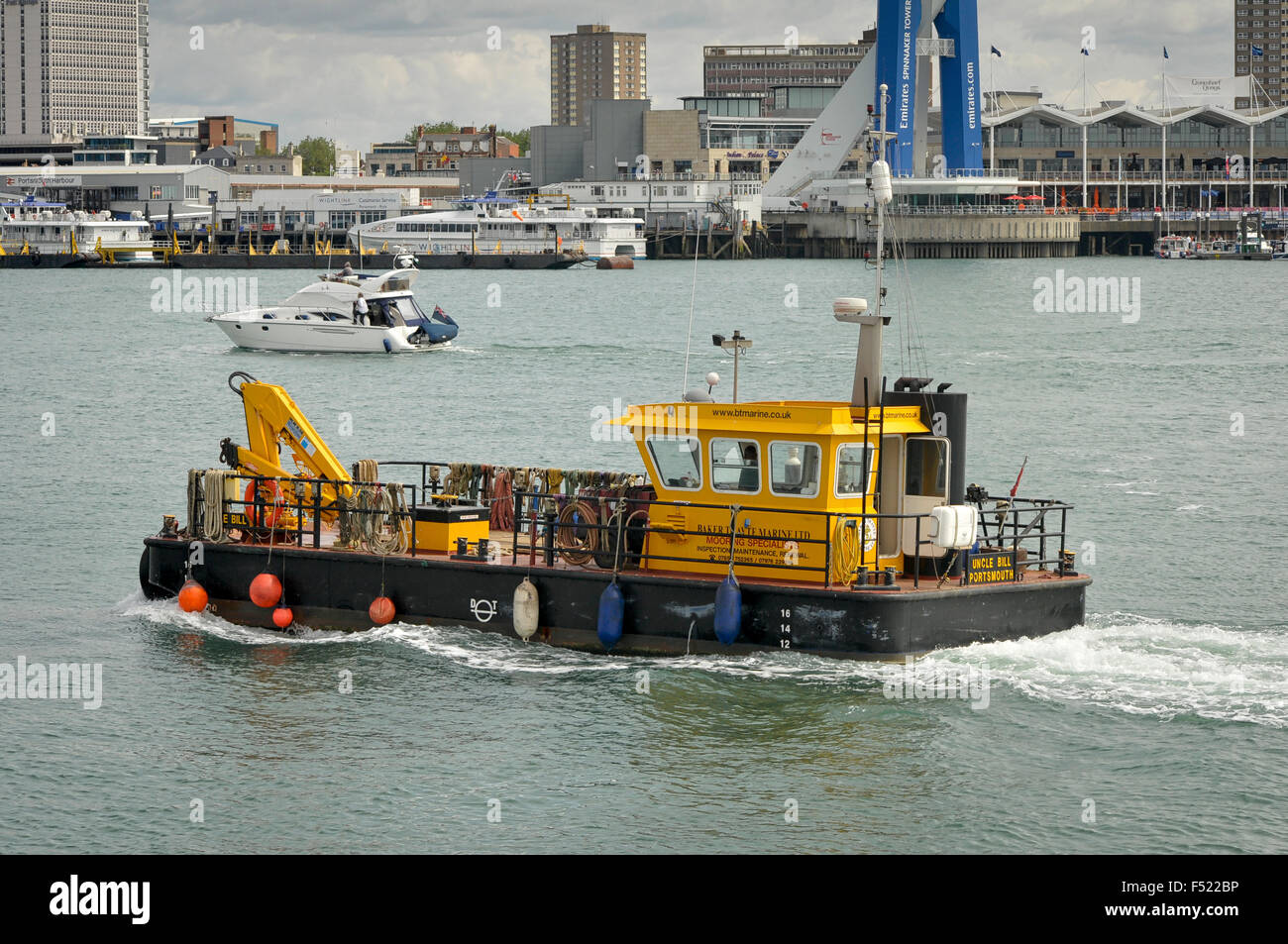 'Old Bill' vessel for checking and laying moorings in Portsmouth Harbour. - Stock Image