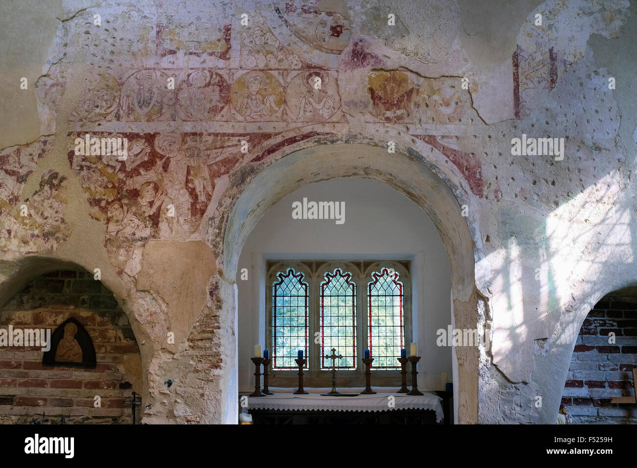 11th century Romanesque wall paintings at Saint Mary's Parish Church, Houghton on the Hill, Norfolk, UK - Stock Image