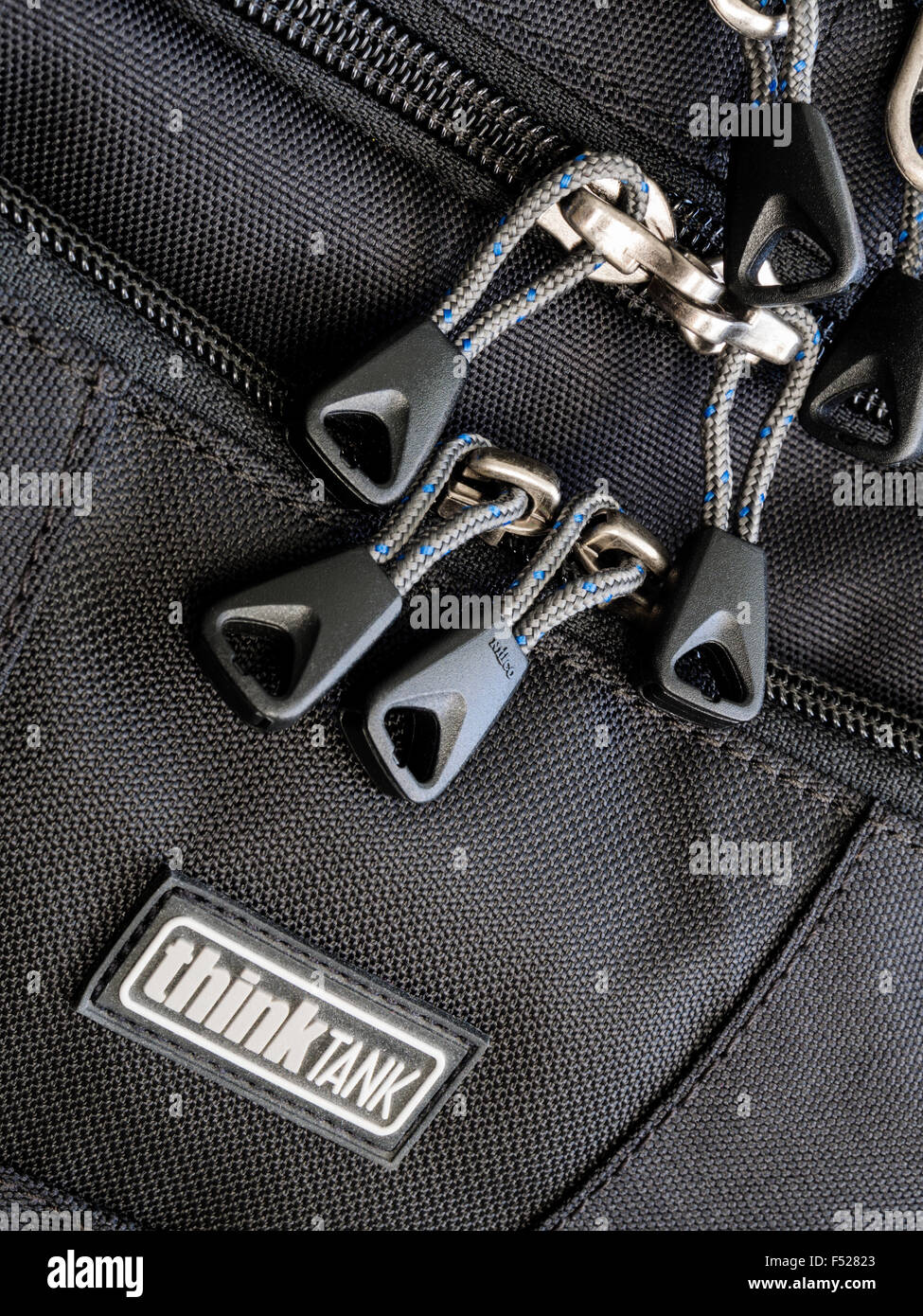 Think Tank Photo Airport Commuter Backpack - close-up of zipper and company logotype, studio shot - Stock Image