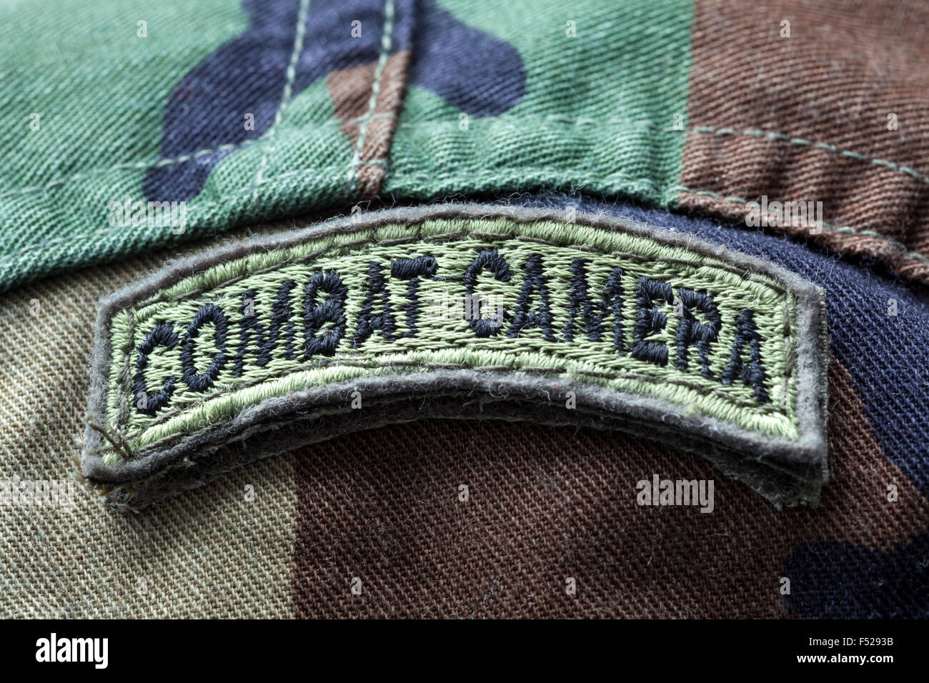 Close-up of Combat Camera army patch on a camo uniform - Stock Image