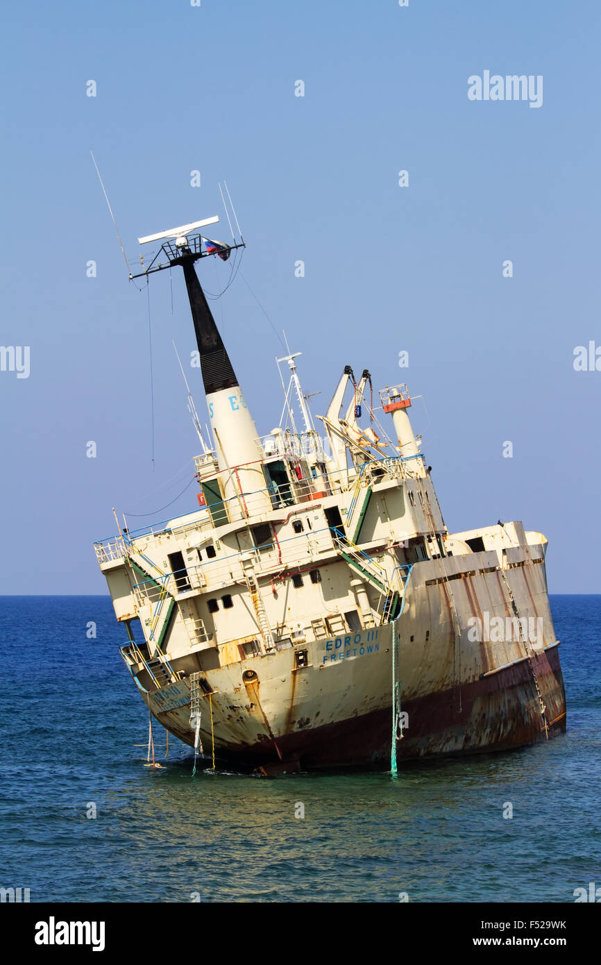 Sea Caves, Cyprus - July 24, 2015: Edro III cargo ship aground near the shore of the Sea Caves at Paphos Cyprus - Stock Image