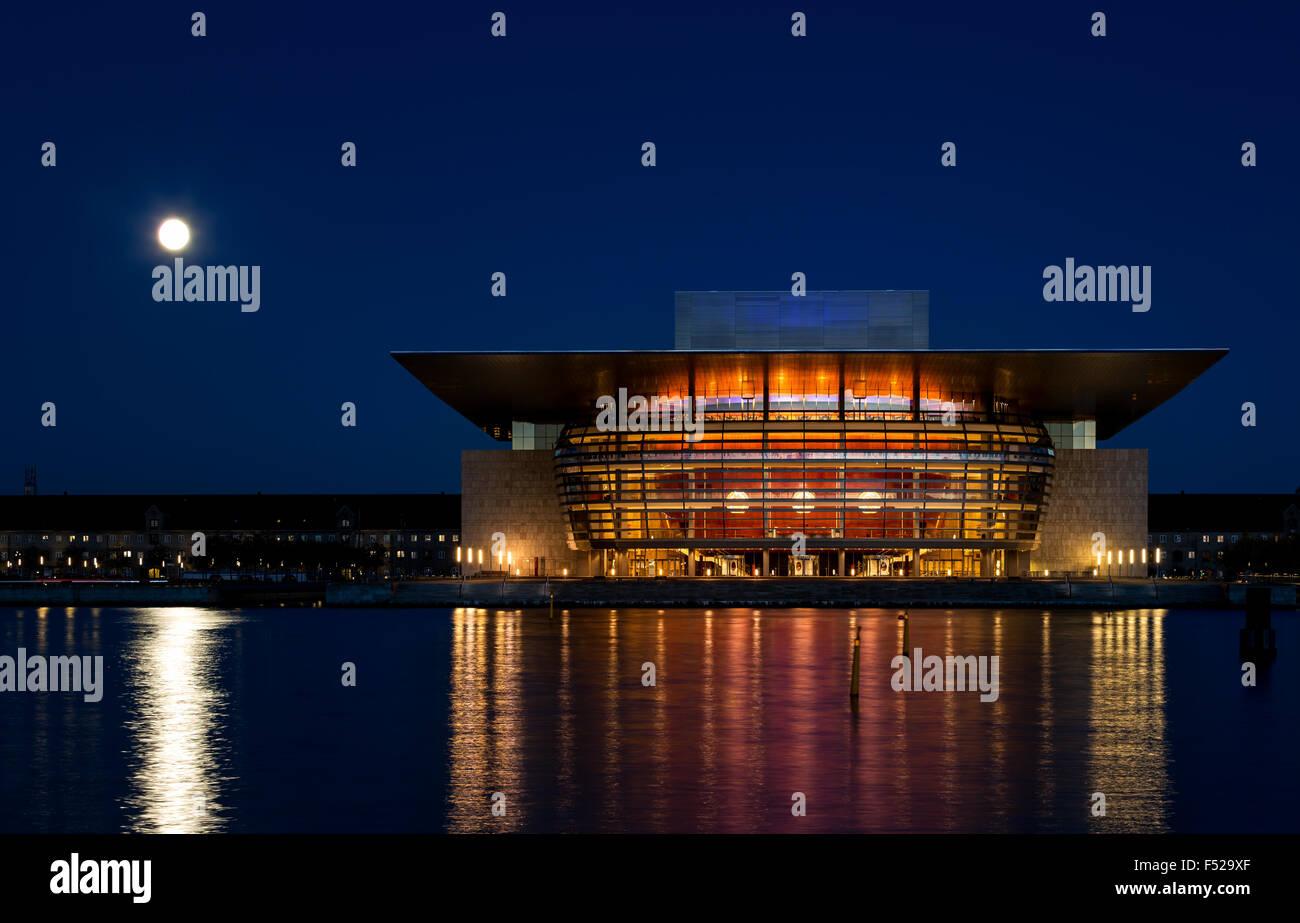 Full moon over Copenhagen Opera House, Copenhagen, Capital Region of Denmark, Denmark - Stock Image