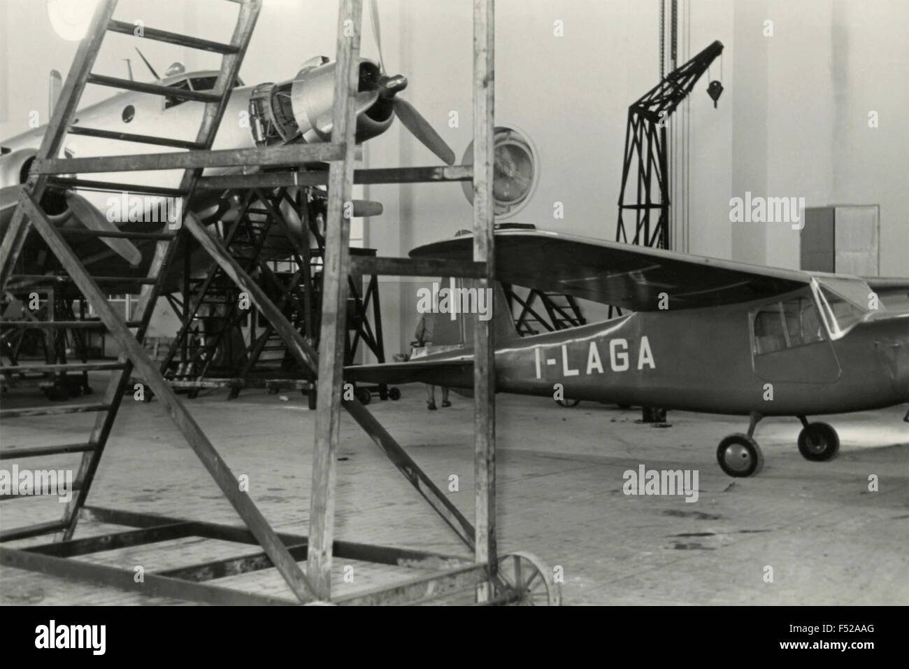 Aermacchi MB 308 light aircraft in the hangar , Italy - Stock Image