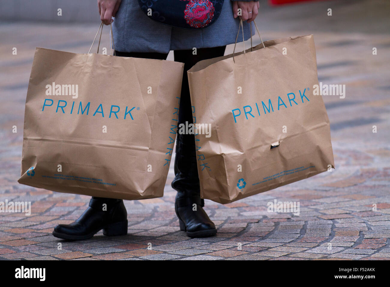 Shoppers with bag of Primark purchases at Houndshill Shopping Centre, Bank Hey St, Blackpool FY1 4RY - Stock Image