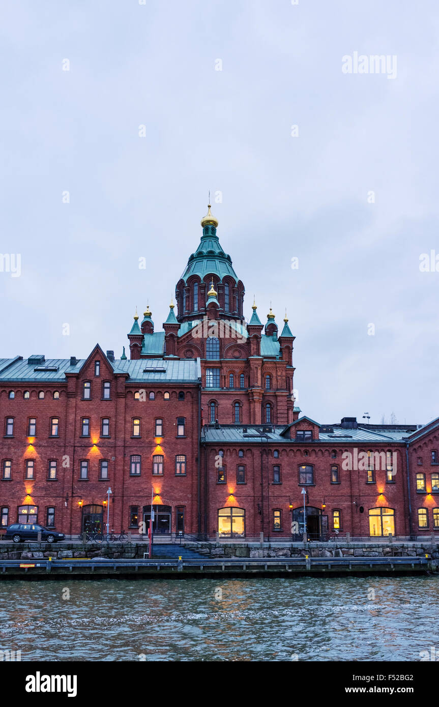 Finland, Helsinki, Uspenski Orthodox Cathedral at dusk. Designed by Russian architect Alexey Gornostaev it was built - Stock Image