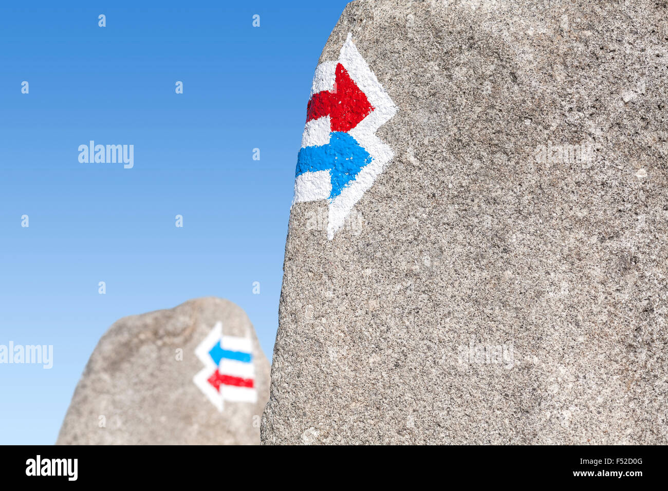 Trail signs painted on rock, choice or dilemma concept. Stock Photo