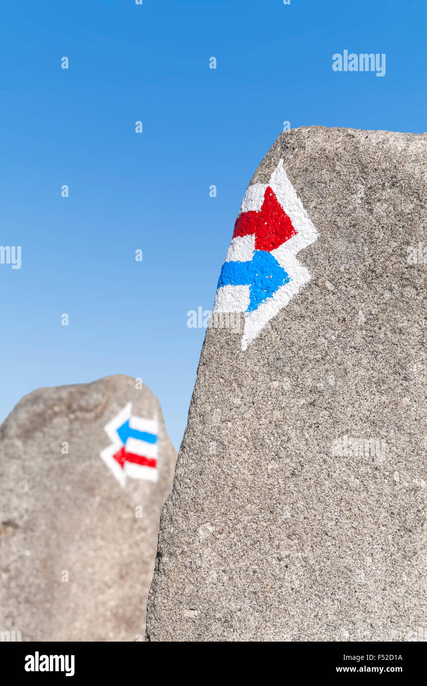 Trail signs painted on rock, choice or dilemma concept. - Stock Image