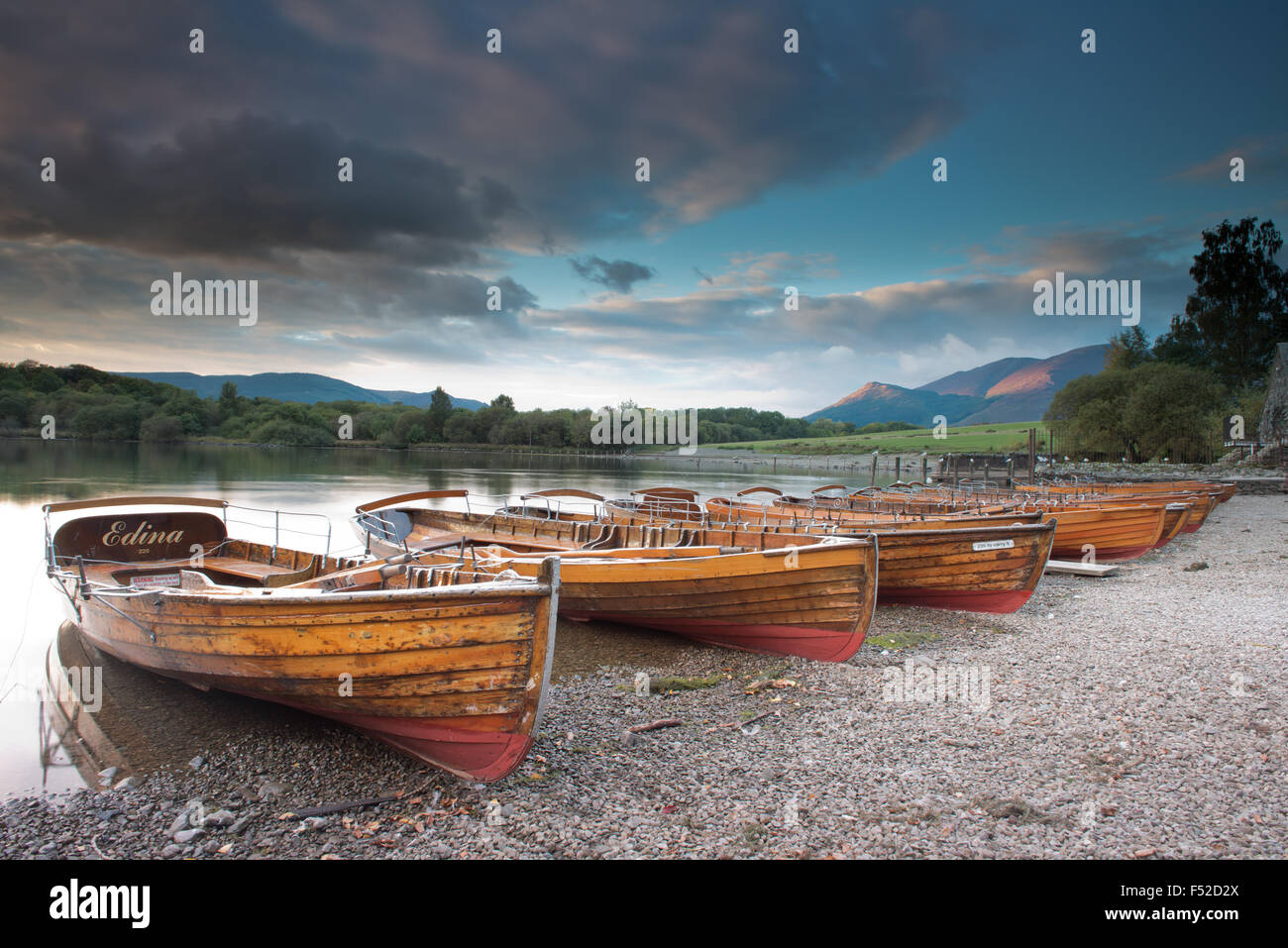 Rowing boats on the shore of Derwent Water near Keswick at sunset, Lake District, Cumbria, England, Uk, Gb - Stock Image