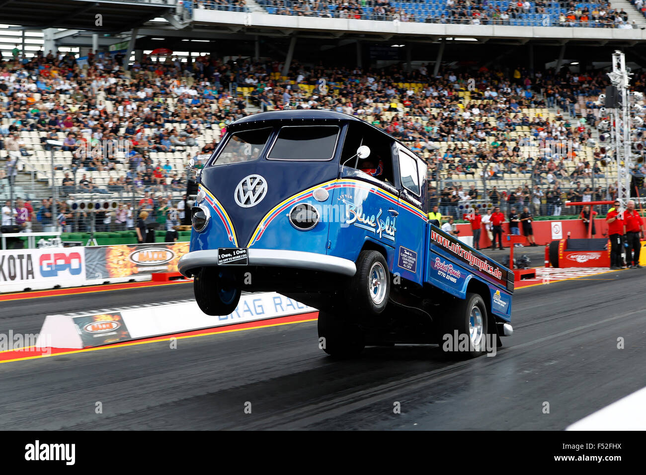 Car, Nitro Olympics Hockenheim in 2011, tuned VW Bus in front of filled tribunes, Wheelie, - Stock Image