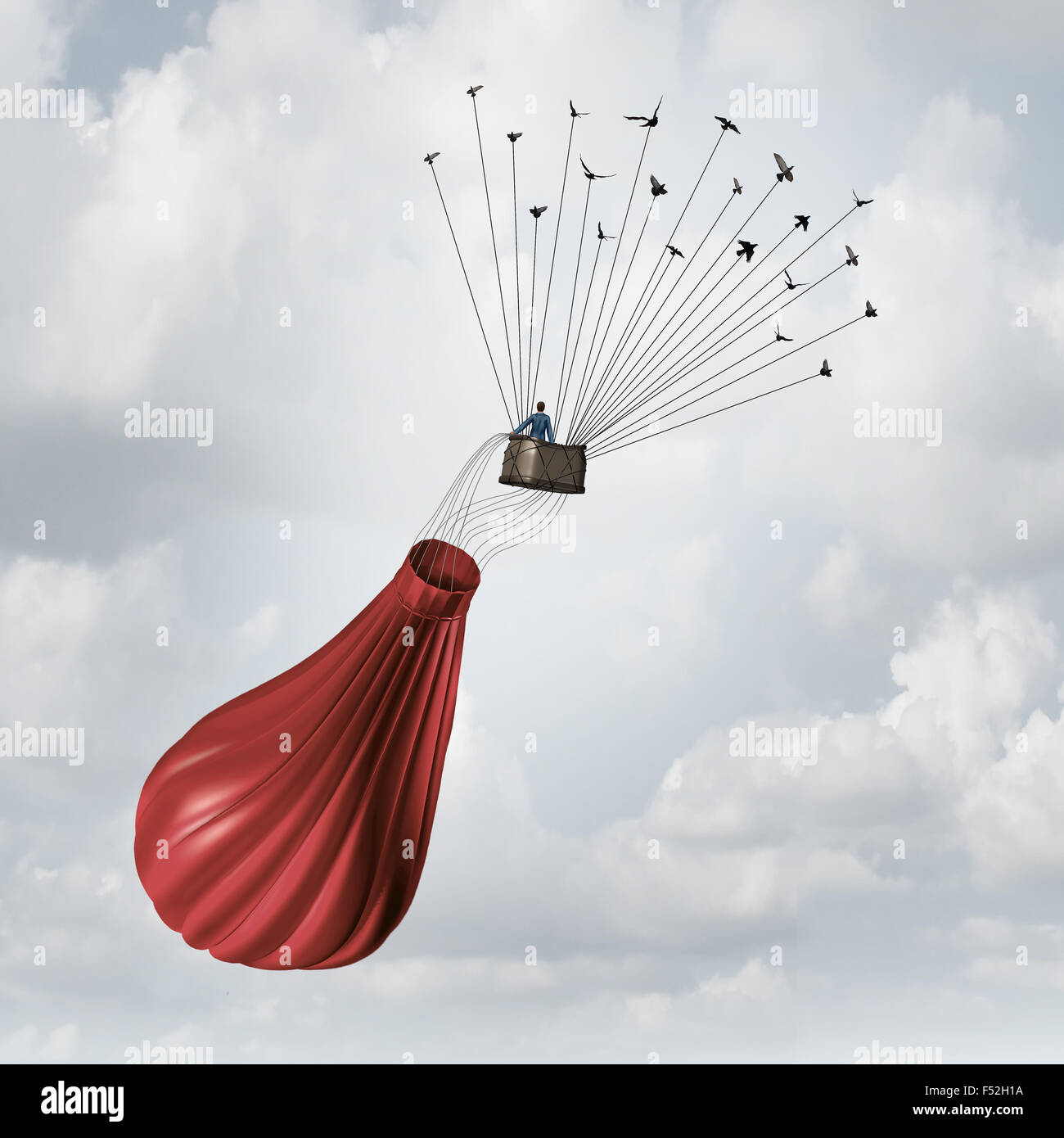 Business team solution concept and teamwork recovery symbol as a businessman in a deflated broken red hot air balloon - Stock Image