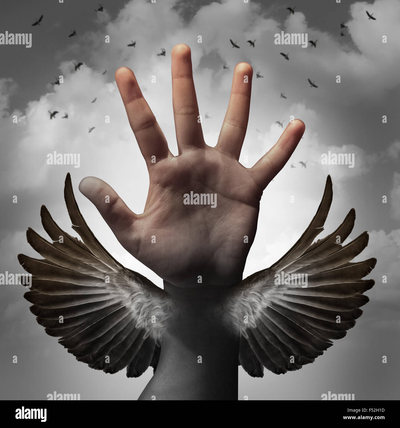 Build self confidence concept and believing in inner potential as a human hand transforming into a bird wing as - Stock Image