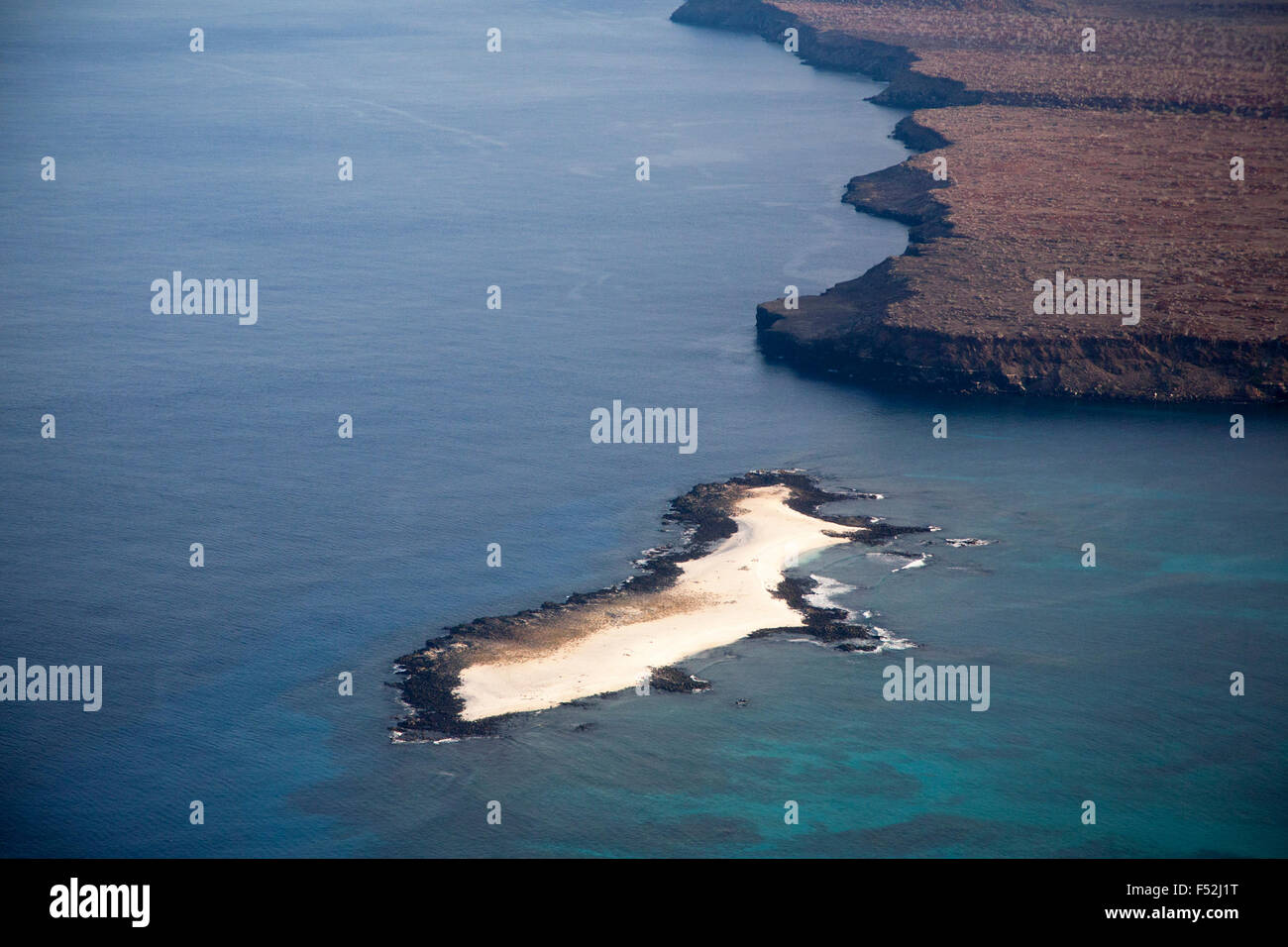 Aerial view of Mosquera islet and part of Baltra island, both a result of geological uplift of submarine lava - Stock Image