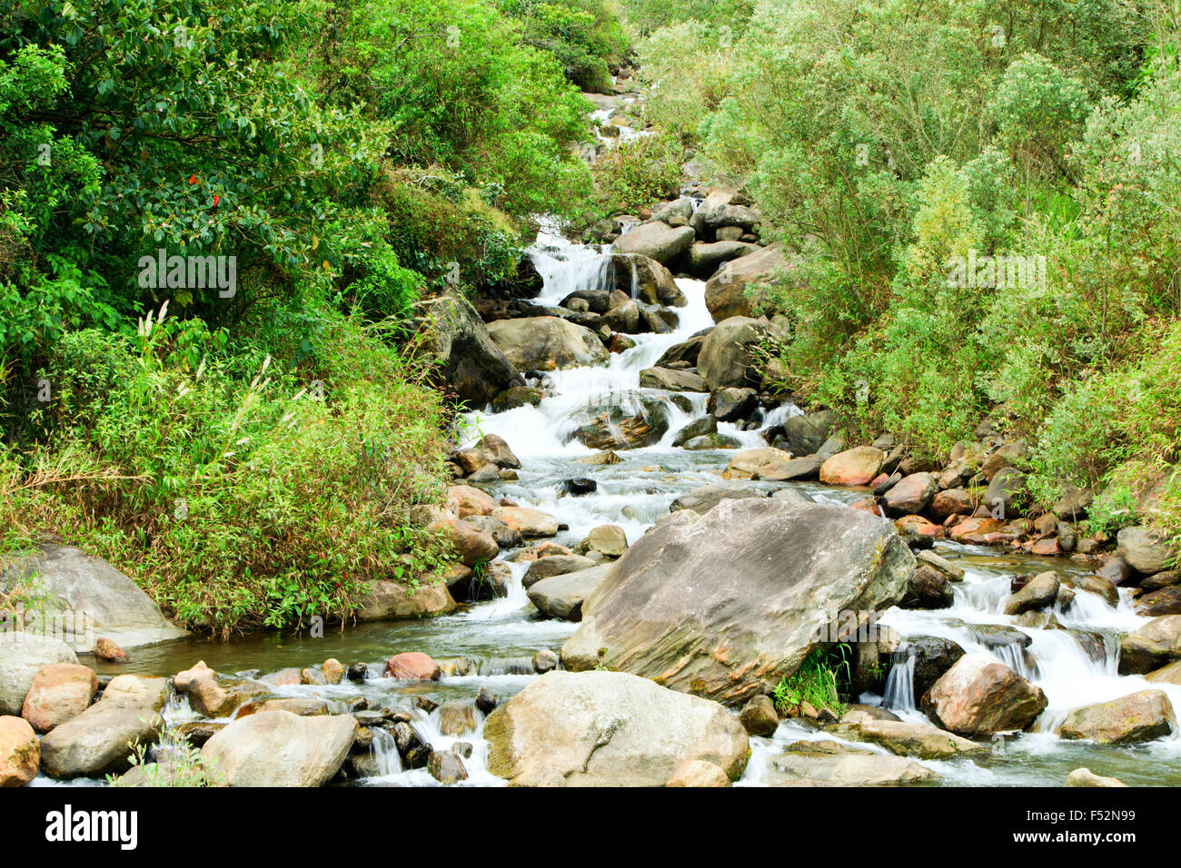 Volcanic Rocks In A Small River Close To Tungurahua Volcano In Ecuador - Stock Image