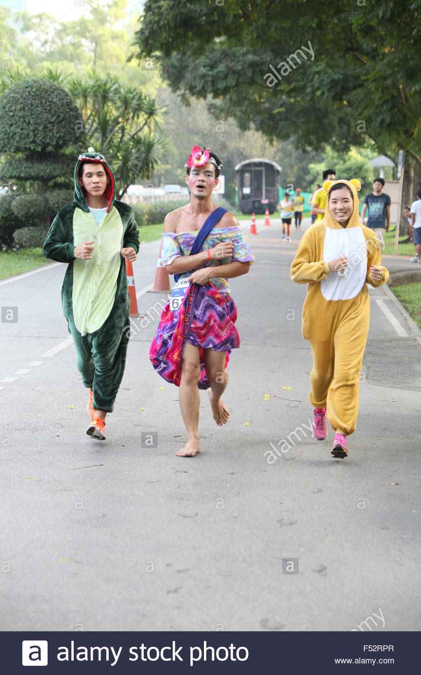 Bangkok - October 23: unidentified runners participates wearing fancy costume in Ekiden 2015 Marathon relay run - Stock Image