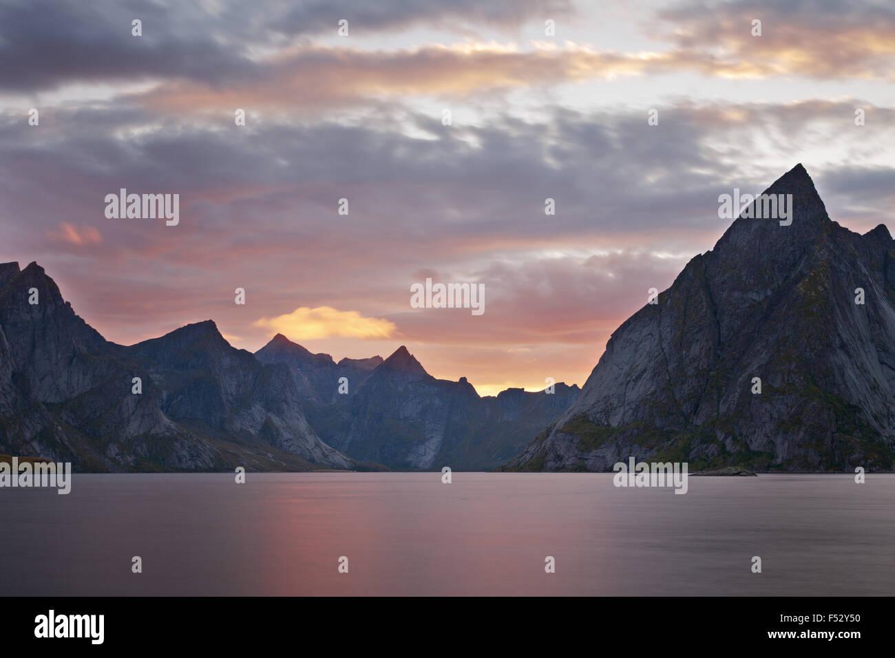 Reine fjord, fjord, Olstinden, Hermannsdalstinden, Lofoten, Norway, sundown - Stock Image