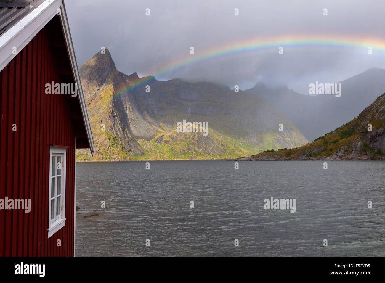 Hut, fjord, rainbow, Olstinden, Lofoten, Norway - Stock Image